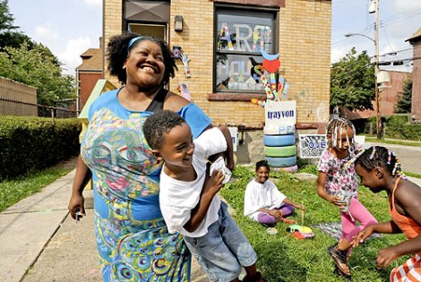Vanessa German plays with Rashaun Daffin, 5, as Art House activities move outdoors in Homewood, Pittsburgh