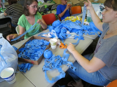 Volunteers working on plastic for Wilder's Grove Project